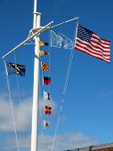 picture of wispy  - Nautical and American Flags Flying from a Ship