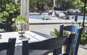stock photo of greek-architecture  - Table in greek restaurant - JPG