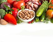 foto of pinto  - Raw pinto beans and vegetables isolated on white - JPG