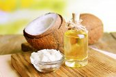 stock photo of massage oil  - Coconut oil on table on light background - JPG