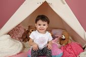 image of teepee  - Toddler child kid engaged in pretend play with stuffed toys and teepee tent - JPG