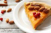image of pumpkin pie  - Homemade pumpkin pie on table - JPG