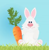 picture of dangling a carrot  - Merry easter bunny with big red carrot - JPG