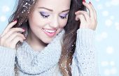 picture of cheer-up  - Winter face close up of young attractive woman covered with snow flakes - JPG