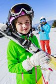 image of family ski vacation  - Ski, skier, snow and fun - skiers enjoying winter vacations  - JPG