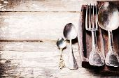stock photo of tables  - Table setting with vintage cutlery on old wooden table - JPG