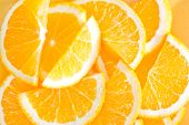 image of valencia-orange  - fresh orange on the yellow plate and on a table - JPG