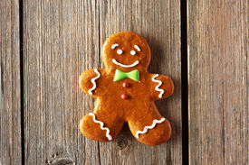 picture of gingerbread man  - Christmas homemade gingerbread man on wooden table - JPG