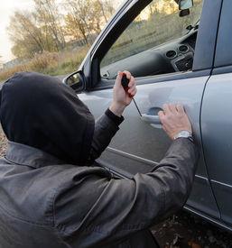 picture of hooligan  - Hooligan breaking into the car - JPG