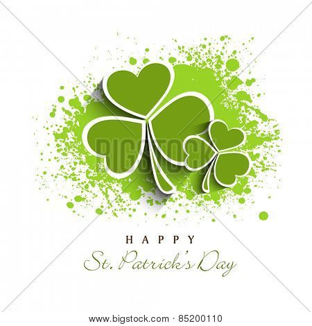 Happy St. Patrick's Day celebration greeting card design with Irish lucky shamrock leaves on green color splash background.