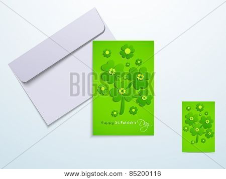 Beautiful greeting card design decorated with Irish lucky shamrock and clover leaves with envelope for Happy St. Patrick's Day celebration.