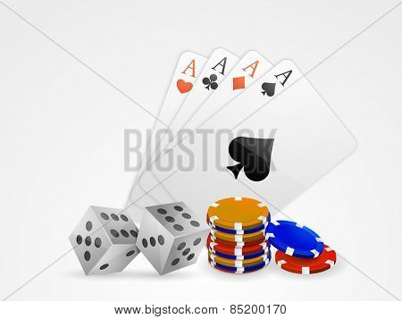 Glossy playing cards with dice and colorful casino chips stack on grey background.