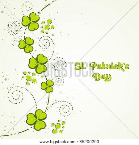 Elegant greeting card design with Irish lucky green clover leaves for Happy St. Patrick's Day celebration.