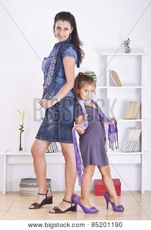 Mom and kid posing in mother clothes