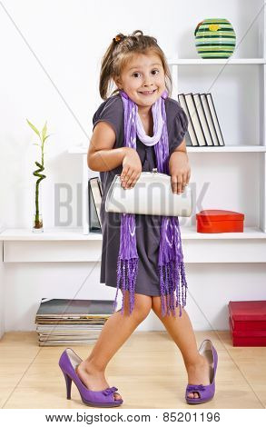 little girl in mother clothes