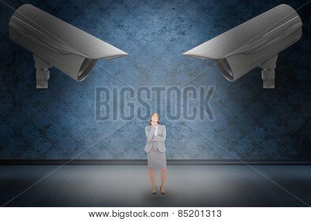 Thoughtful businesswoman against dark grimy room
