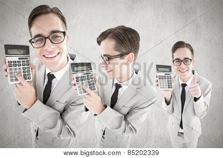 Nerd with calculator against white and grey background