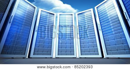 Server room against bright blue sky with clouds