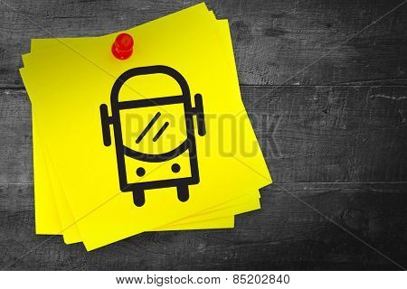 Bus graphic against sticky note with red pushpin