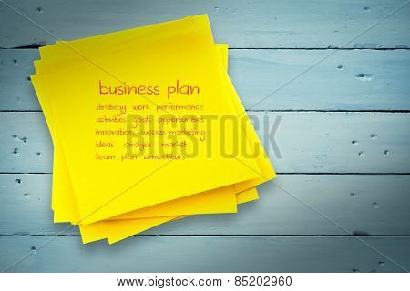Business plan against sticky note