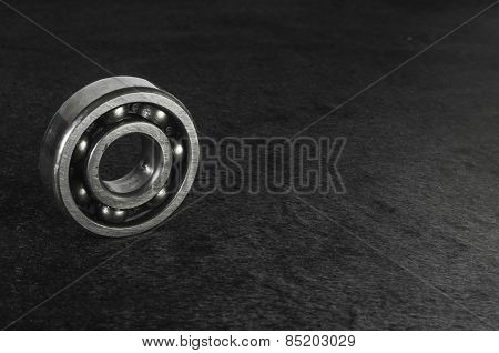 Ball bearings on black flannel background