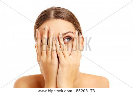 A picture of a terrified woman covering her face over white background