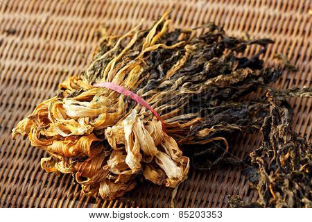 Chinese dried white cabbage on bamboo background