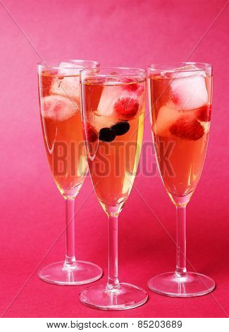 Celebration. Glass of champagne on a pink background