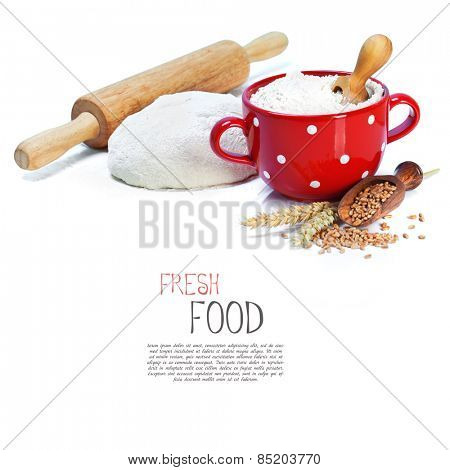 Dough and rolling pin over white background