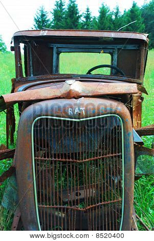Rusty Old Car in a Junkyard