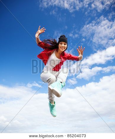 sport, dancing and urban culture concept - beautiful dancing girl jumping