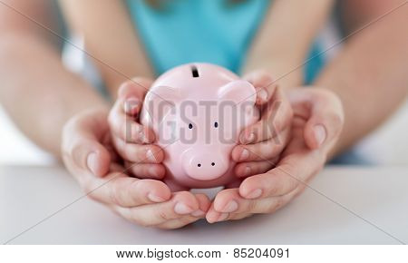 family, children, money, investments and people concept - close up of father and daughter hands hold