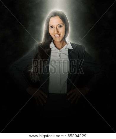 Close up Glowing Head and Shoulders of a Smiling Businesswoman, with Hands on her Waist, on Black Background