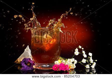 hot tea splashing in the glass
