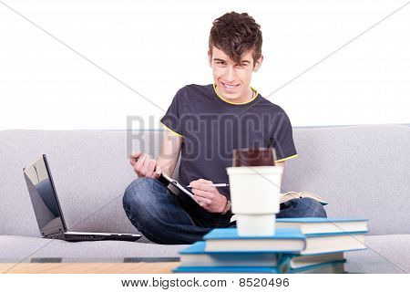 Young Male Student Studying
