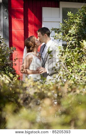 bride and groom having private moment together