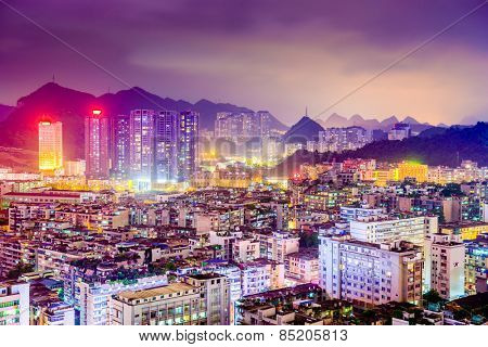 Guiyang, China downtown cityscape and Karst mountains.