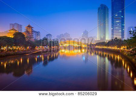 Chengdu, China cityscape over the Jin River and Anshun Bridge.