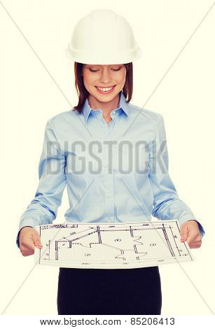 building, developing, consrtuction and architecture concept - smiling businesswoman in white helmet looking at blueprint
