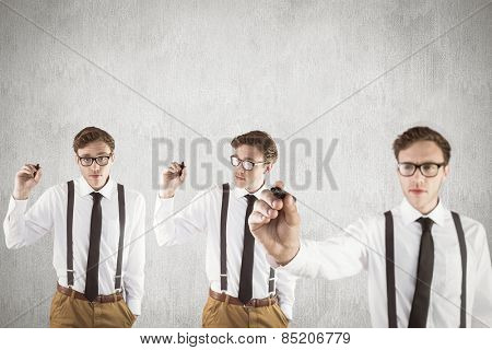 Nerdy businessman writing against white and grey background