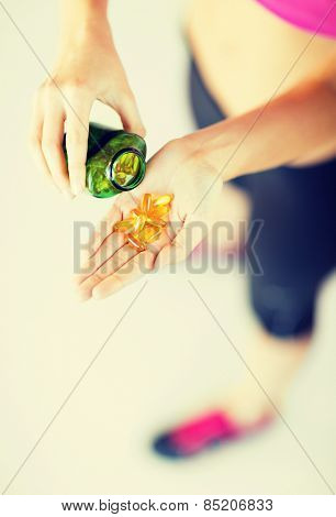 sport and diet concept - woman hand with medication