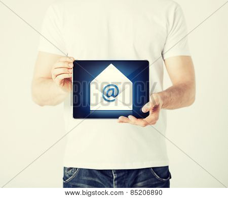 picture of man holding tablet pc with email sign
