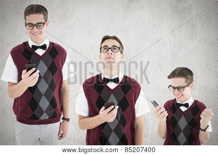 Nerd with smartphone against white and grey background