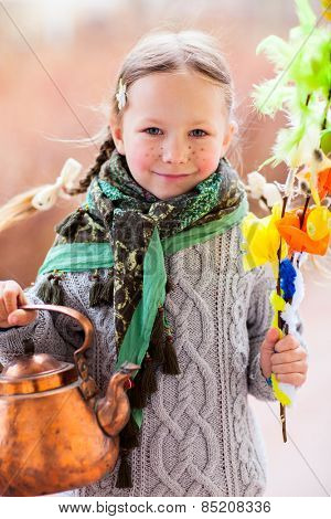 Adorable little girl outdoors dressed for Easter traditional celebration in Finland