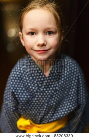 Portrait of adorable little girl wearing yukata traditional Japanese kimono