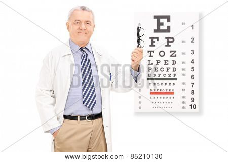 Optometrist holding glasses in front of eye chart isolated on white background