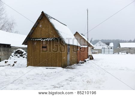 Wooden Constructions Under Snow