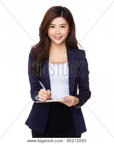 Young Asian businesswoman write on clipboard