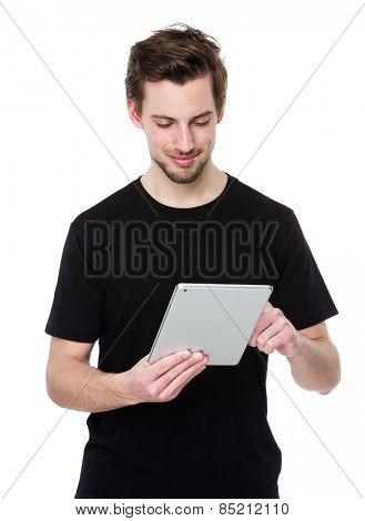 Young man holding a touch pad tablet PC