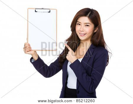 Young Asian businesswoman point to blank clipboard